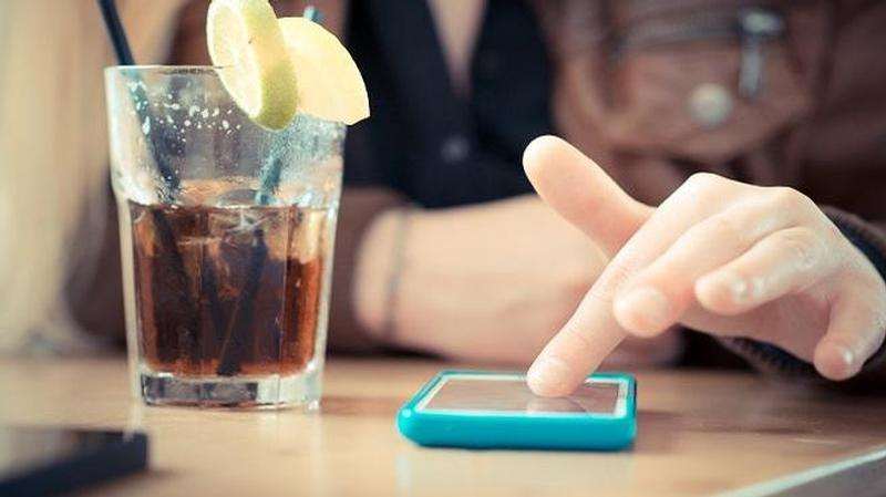 graphicstock close up of woman hands using smart phones at the bar b6bbrbskw 1